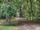 Maison unifamiliale for sales at Pristine Wooded Estate Lot With Cabin 5143 Riverview Road Sandy Springs, Georgia 30327 États-Unis