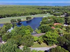 Single Family Home for  sales at Lake Front Home at Ocean Reef 23 Dilly Tree Park  Ocean Reef Community, Key Largo, Florida 33037 United States