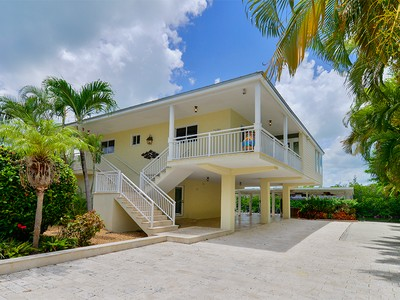 Single Family Home for sales at Magnificent Canal Front Home 128 Venetian Drive Islamorada, Florida 33036 United States