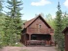 Vivienda unifamiliar for sales at Custom Chalet Style Home 35 Walker Road Essex, Montana 59916 Estados Unidos