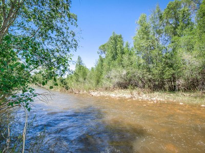 Land for sales at 23.74 acres set on the Weber River offering acreage, excellent river frontage 4359 N Millrace Rd Oakley, Utah 84055 United States