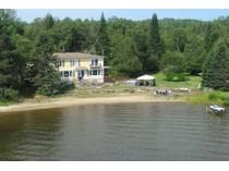 Maison unifamiliale for sales at Lac-des-Plages 2388 Ch. du Tour-du-Lac   Lac-Des-Plages, Québec J0T1K0 Canada
