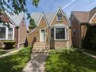 Частный односемейный дом for sales at Spacious Freshly Painted Home! 6840 W. Armitage Avenue Chicago, Иллинойс 60707 Соединенные Штаты