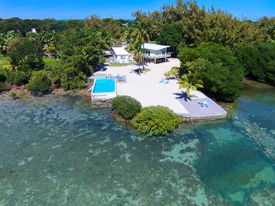 Single Family Home for sales at Oceanfront Estate with Guest Cottage 82703 Old Hwy Islamorada, Florida 33036 United States