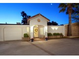 Property Of Gorgeous Classic Burnt Adobe Home in Historic Harold Bell Wright Estates