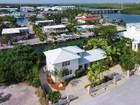 Maison unifamiliale for sales at Stunning Canal Front Home 175 Harbor Drive Plantation Key, Florida 33070 États-Unis