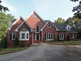Einfamilienhaus for sales at Spacious Lakefront Home Sanctuary 216 Wood Cliff Court McDonough, Georgia 30252 Vereinigte Staaten