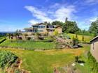 Vivienda unifamiliar for sales at 494 Dungeness Dr  Fox Island, Washington 98333 Estados Unidos