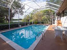 Nhà ở một gia đình for sales at Lake Front Home at Ocean Reef 23 Dilly Tree Park Key Largo, Florida 33037 Hoa Kỳ