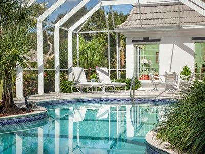 Vivienda unifamiliar for sales at PELICAN BAY - PELICAN BAY WOODS 705  Hollybriar Ln  Naples, Florida 34108 Estados Unidos