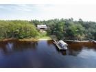 Casa Unifamiliar for  sales at CONTEMPORARY ACADIAN ON DEEP WATER 120  Bayou Dr Niceville, Florida 32578 Estados Unidos