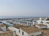 Property Of A stunning apartment within Puerto Banus