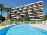 Property Of Cannes, seaside building with swimming pool.