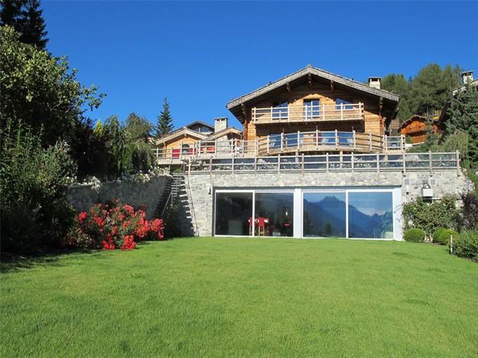 Casa para uma família for sales at A stylish home in a shrine of greenery  Crans, Valais 3963 Suíça