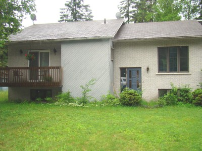 Bungalow for a-vendre at 575 Rue Albert  Mont-Tremblant, Quebec J8E 2T7 Canada