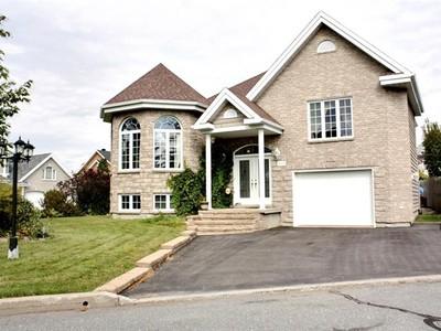 Unifamiliale for a-vendre at 215 Rue De La Coulée  Mont-Saint-Hilaire, Quebec J3H 5Z6 Canada
