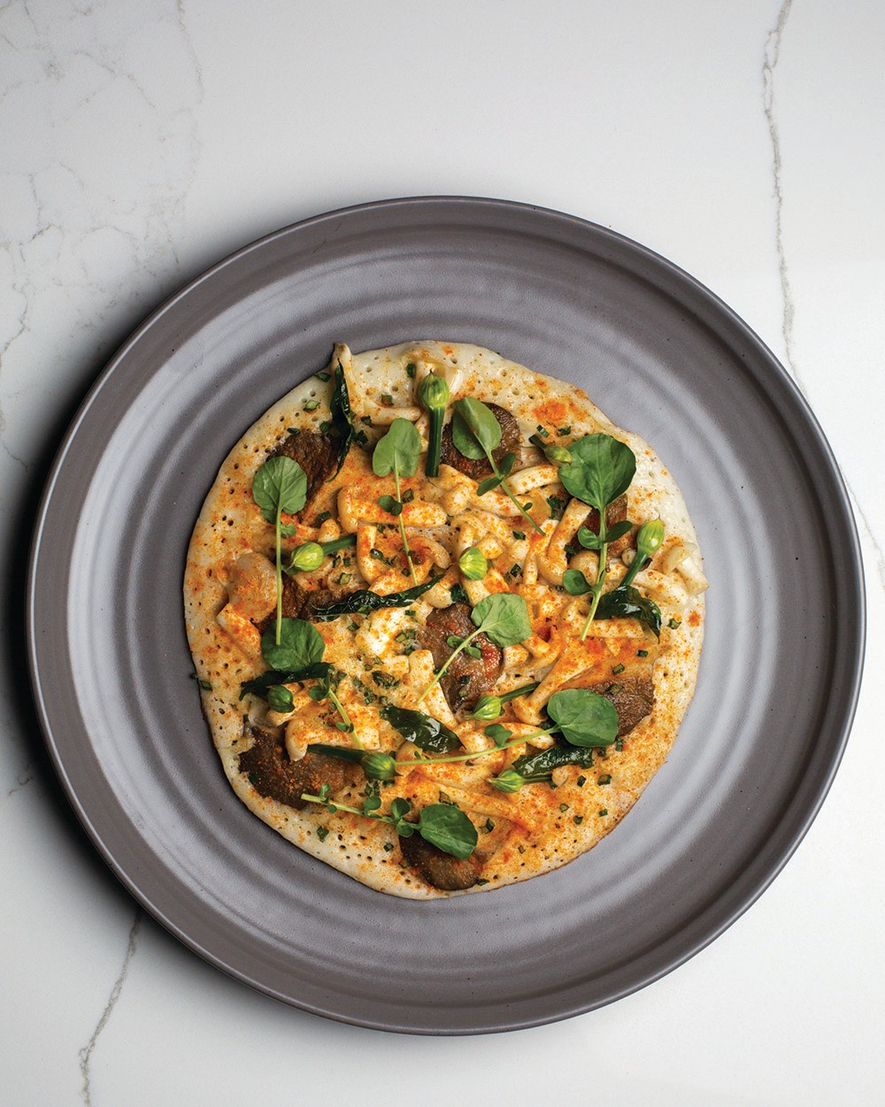 A mushroom uttapam with both wild and cultivated mushrooms from Rasa