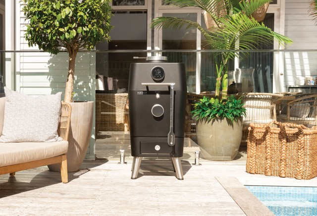 The Everdure 4K Electric Ignition Charcoal Grill is a reimagining of the backyard barbecue classic