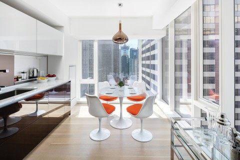A dining room with pops of color by Ximena Rodriguez