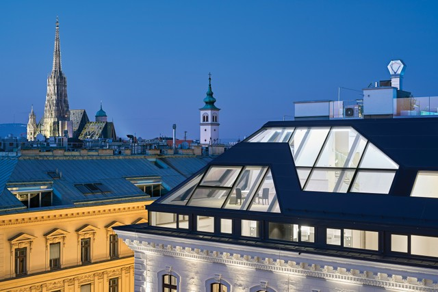 A luxury penthouse with a view of historic Vienna. Palais Herzfeld, shown at top right, has an impressive outdoor entertaining space